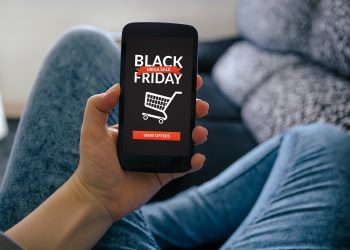 Girl holding smart phone with Black Friday concept on screen. All screen content is designed by me
